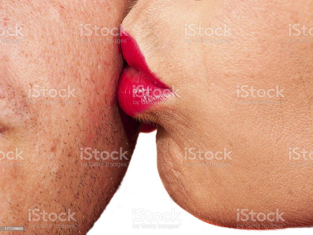 Woman kissing man's cheek stock photo