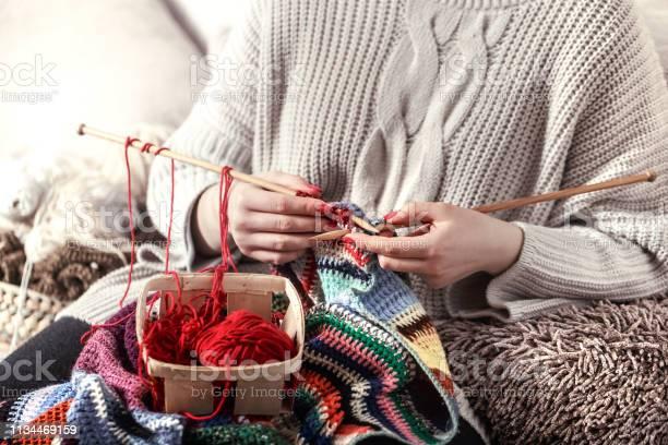 Woman knits knitting needles on the couch picture id1134469159?b=1&k=6&m=1134469159&s=612x612&h=hckamuzbkdukxf08pa1cdpuqrvjnc5j10dohizuza30=
