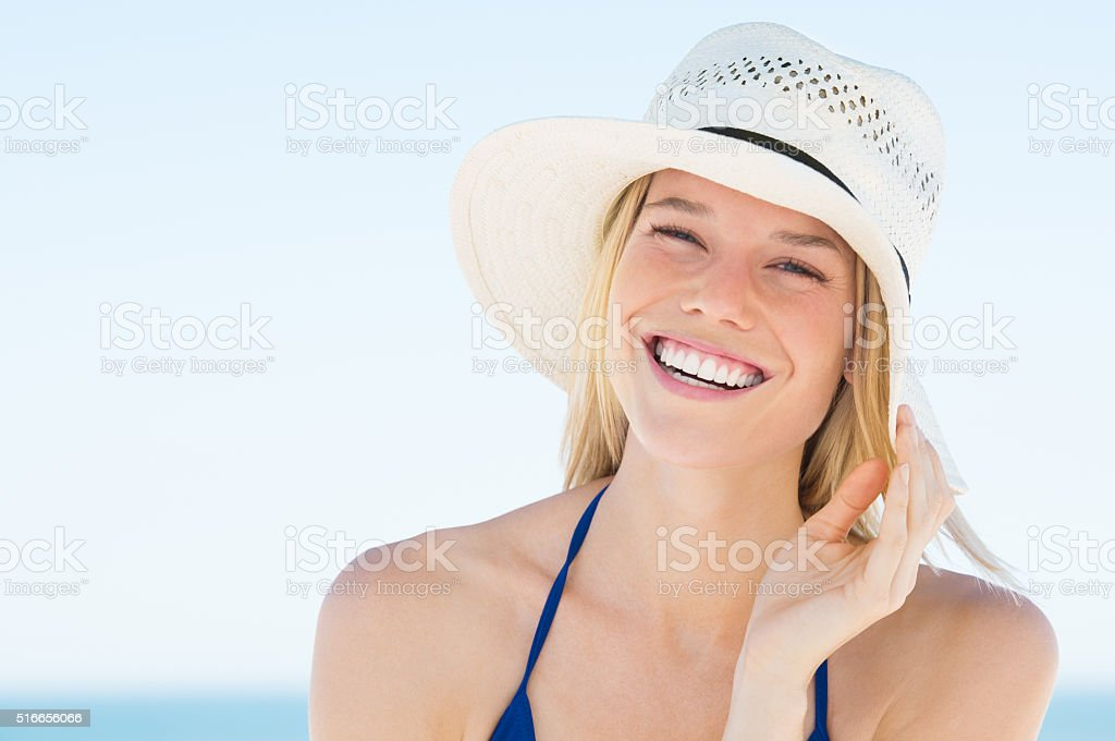 Woman laughing at beach stock photo
