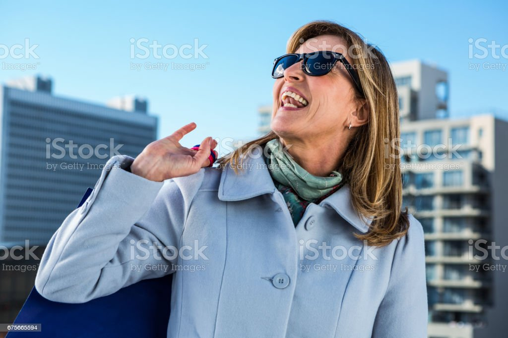 Woman laughing in town royalty-free stock photo