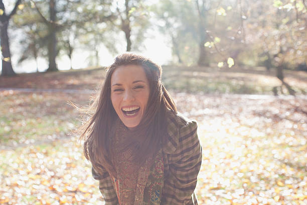 Woman laughing outdoors in autumn leaves picture id98843721?b=1&k=6&m=98843721&s=612x612&w=0&h=ph3ct0yyk8lpdhgtk52d9kguadvofshp3ukahqwqyxq=