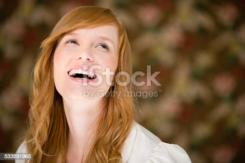 istock Woman laughing 533891965