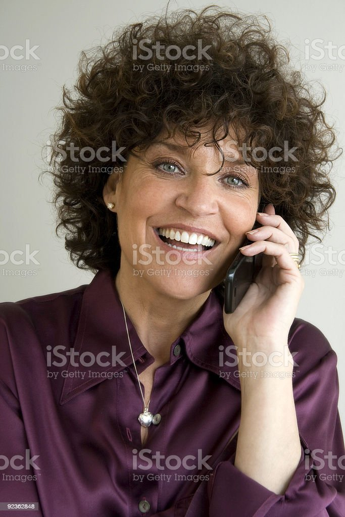 woman laughing with cell phone royalty-free stock photo