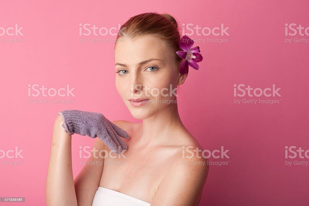woman, lavender flower hair pin, bath glove royalty-free stock photo