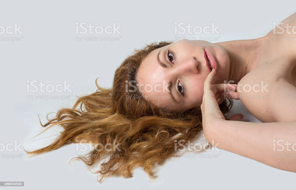 Woman lay down and her red hair spread stock photo