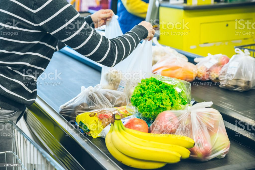 woman lay out product on the line stock photo