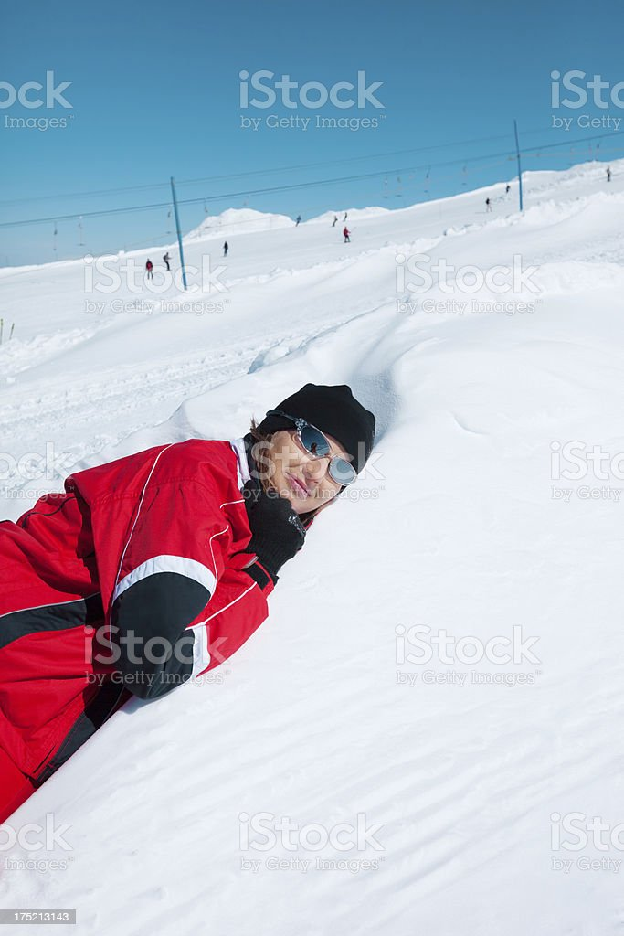 Woman laying down in the snow royalty-free stock photo