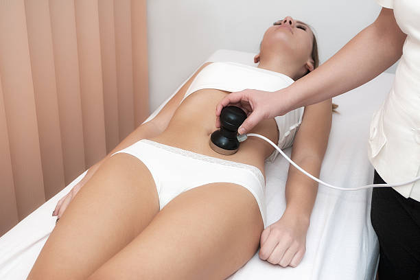 Woman laying down receiving cavitation treatment