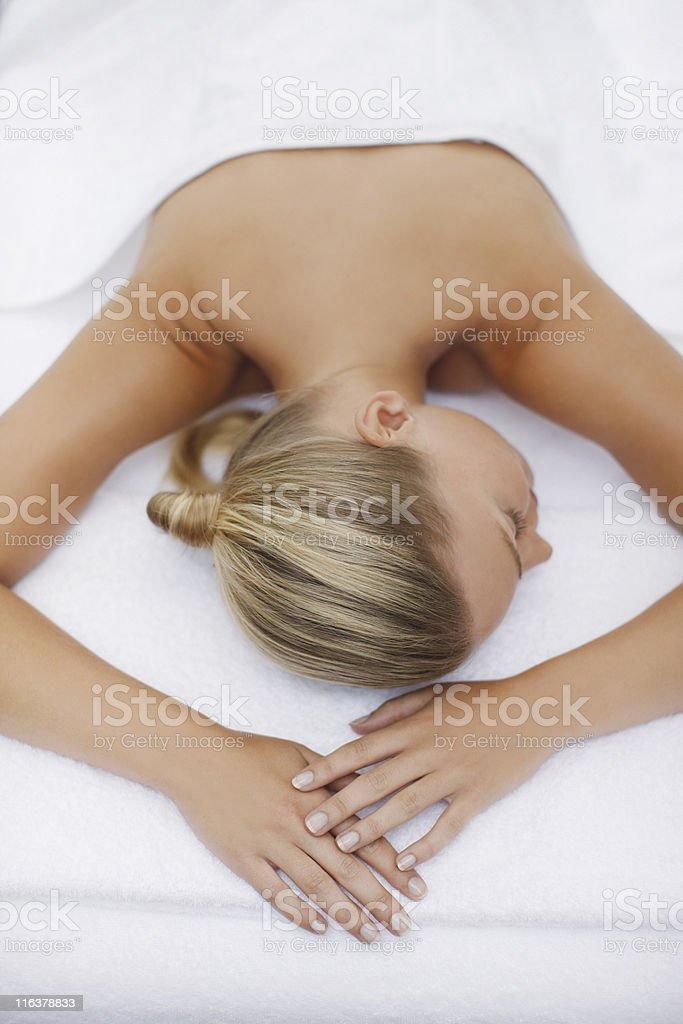 Woman laying on massage table stock photo