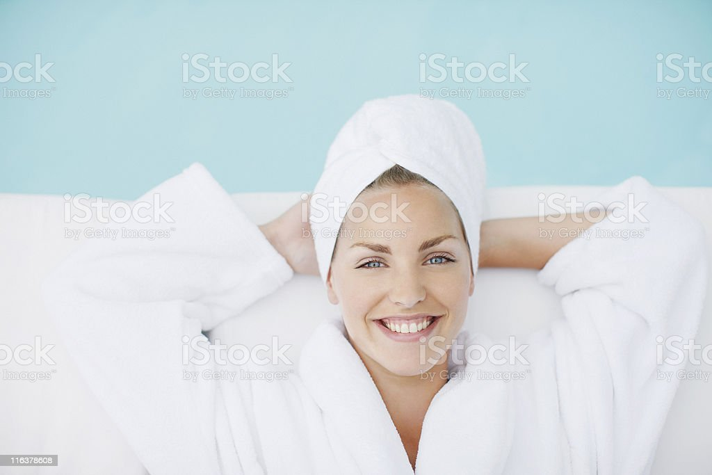Woman laying poolside stock photo