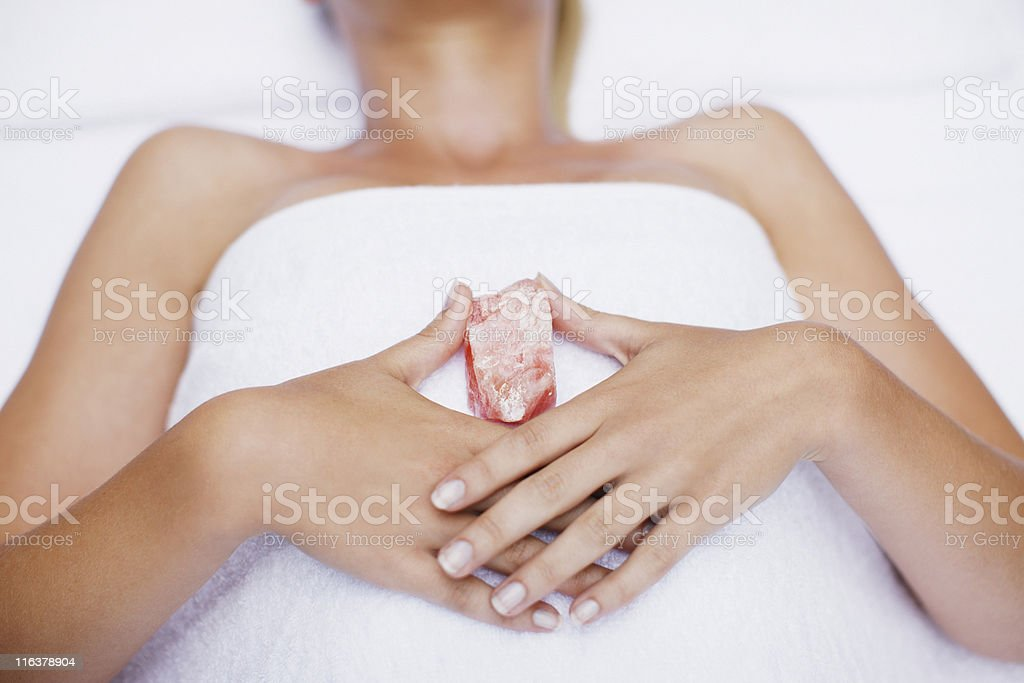 Woman laying with crystal stock photo