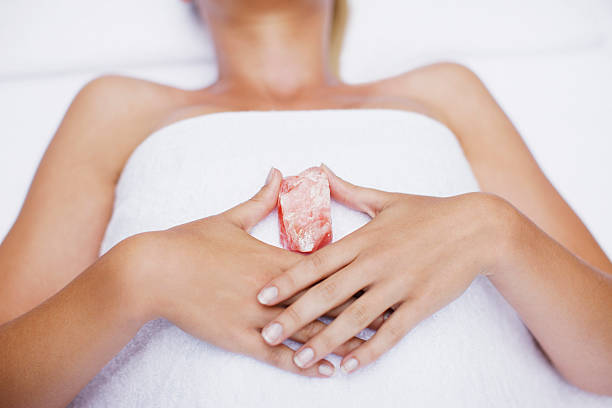 Woman laying with crystal  crystal healing stock pictures, royalty-free photos & images