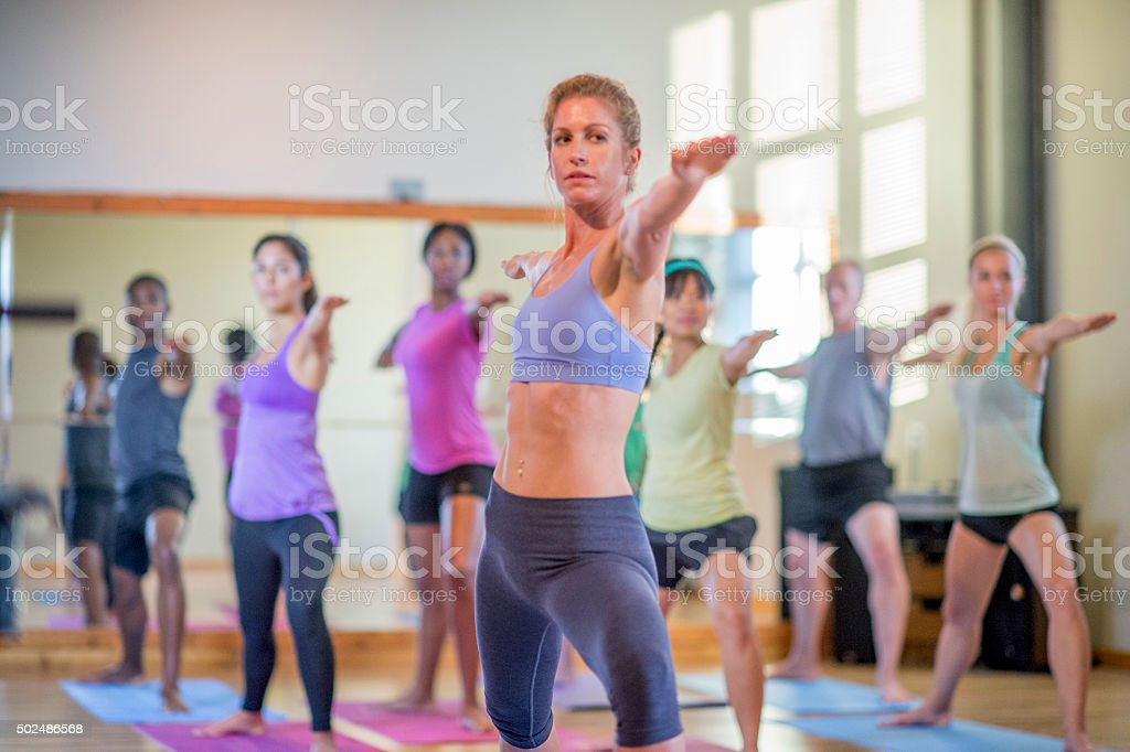 Woman Leading a Yoga Class stock photo