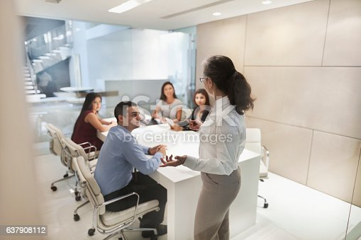 672116416istockphoto Woman leading business presentation in conference room 637908112