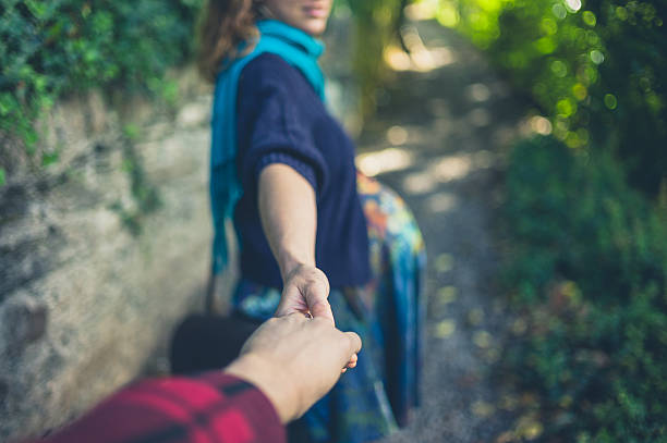 woman leading her boyfriend - england stock photos and pictures