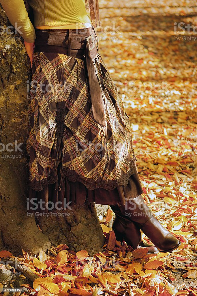 Woman leaned back on old tree stock photo