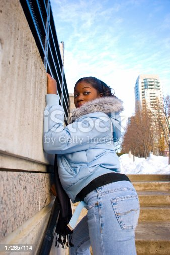 istock Woman leaning against concrete surface. 172657114