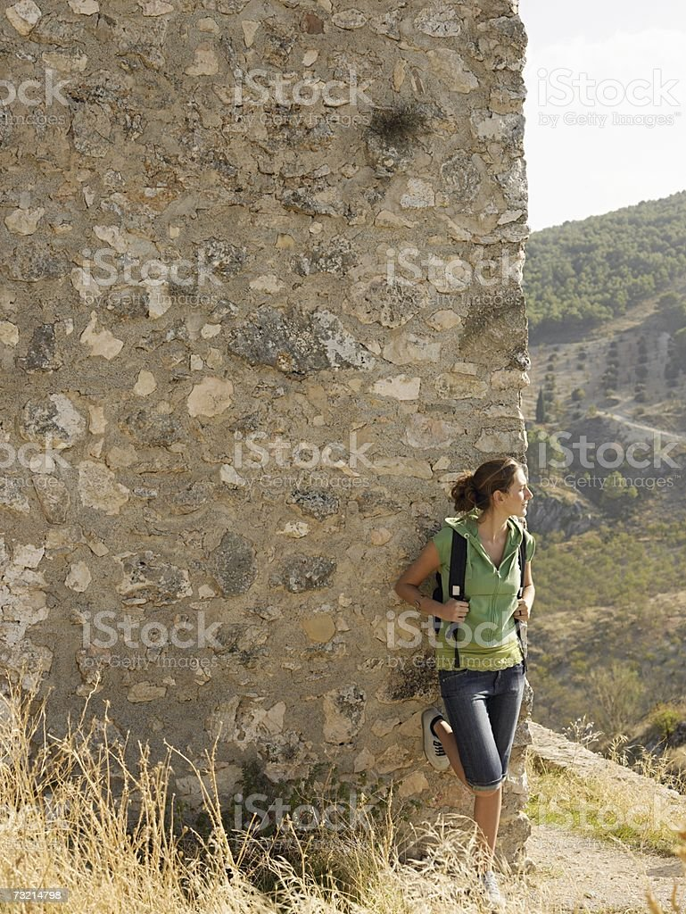 Woman leaning against wall royalty-free stock photo