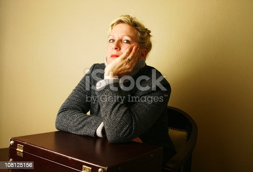 981750034istockphoto Woman Leaning on Brief Case 108125156