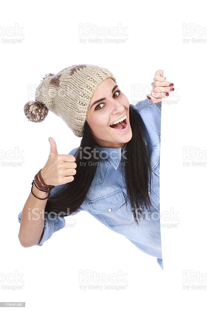 woman leaning on white board with thumbs up royalty-free stock photo