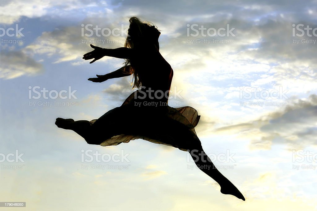 Woman Leaping through the Sky stock photo
