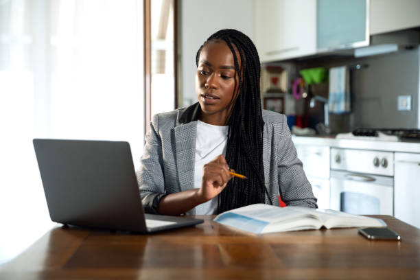 Woman learning and teaching homeschooling in video conference stock photo