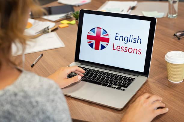 woman learning english online - english foto e immagini stock