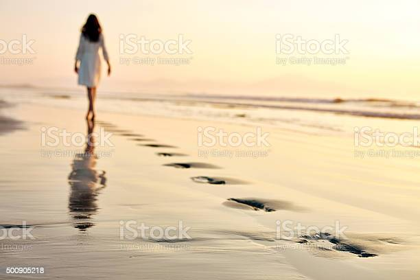 Woman leaving footprints while walking on wet sand at sunset picture id500905218?b=1&k=6&m=500905218&s=612x612&h=aby5yxtpec9bkspebgtxzsfhohvdhdvexbatcf7 r c=