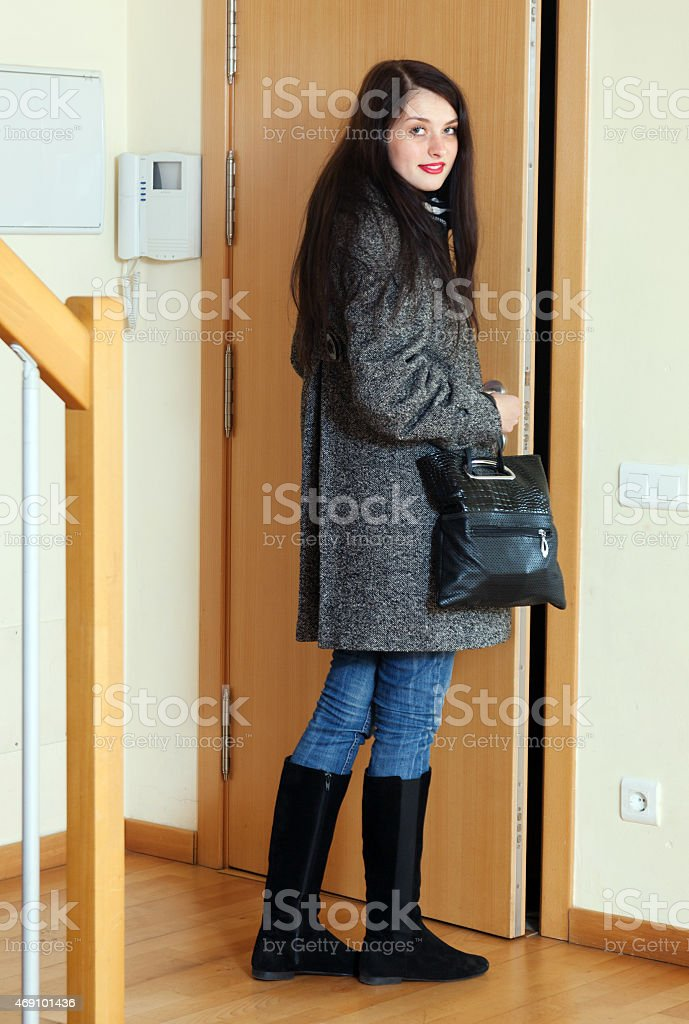 woman leaving  home stock photo