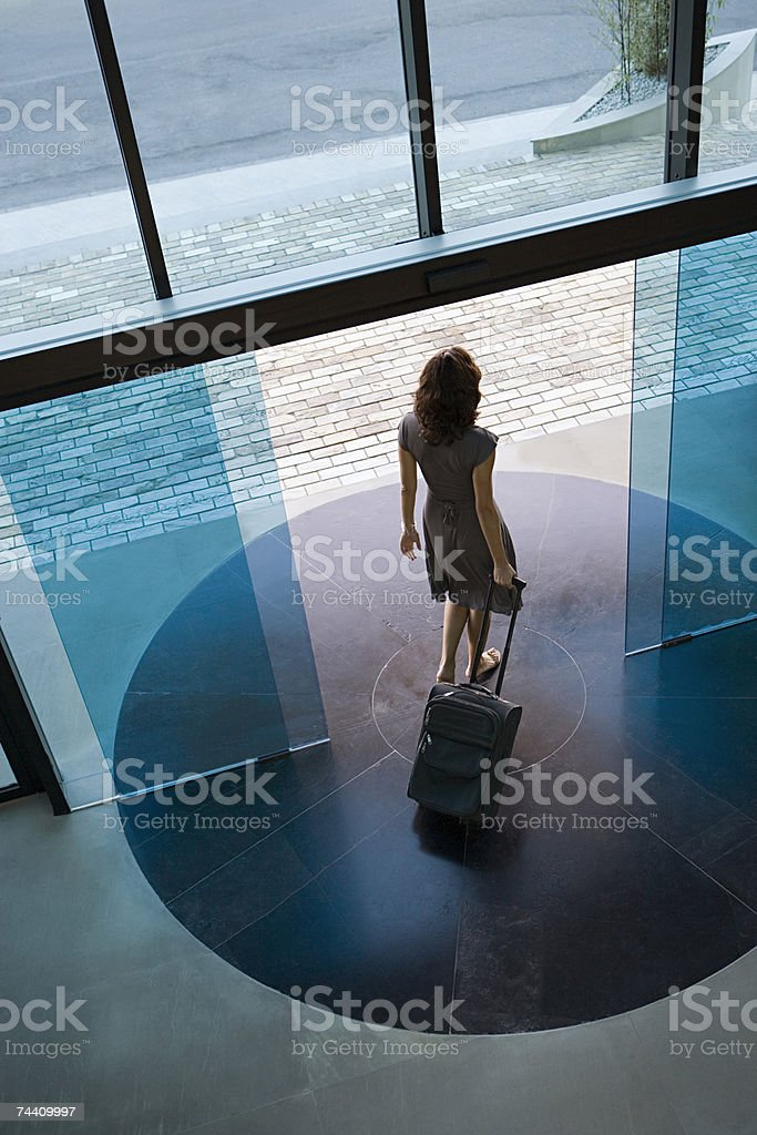 Woman leaving hotel stock photo