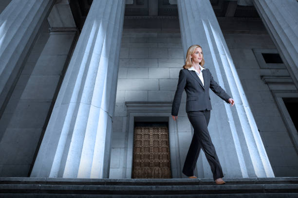 Woman Leaving The Courthouse stock photo