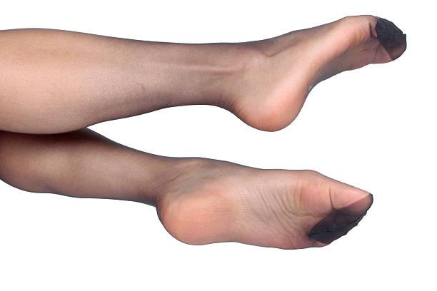 frau beine und füße mit tights - nylon stock-fotos und bilder
