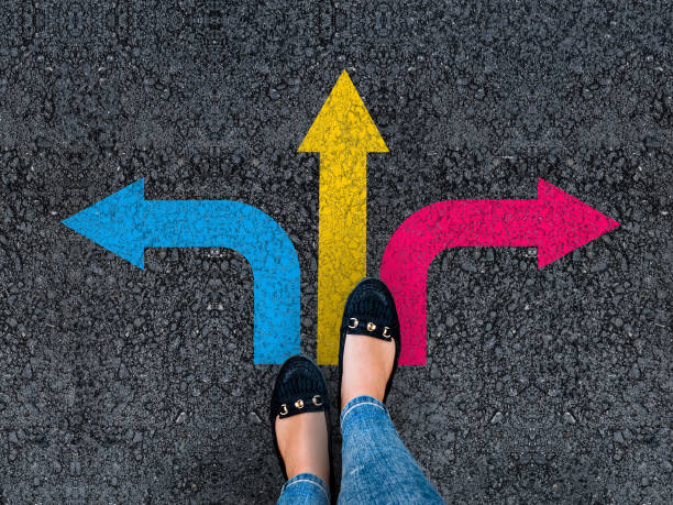 woman legs and three direction arrow choices stock photo
