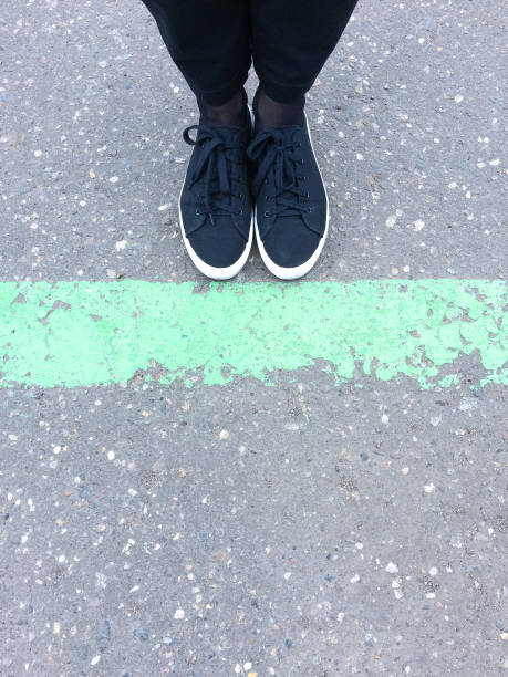 woman legs behind the green line. - low section stock photos and pictures