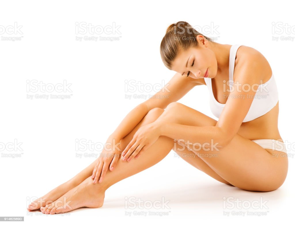 Woman Legs Body Beauty, Sitting Female in White Underwear Touching Leg, Girl Skin Care Hair Removal stock photo