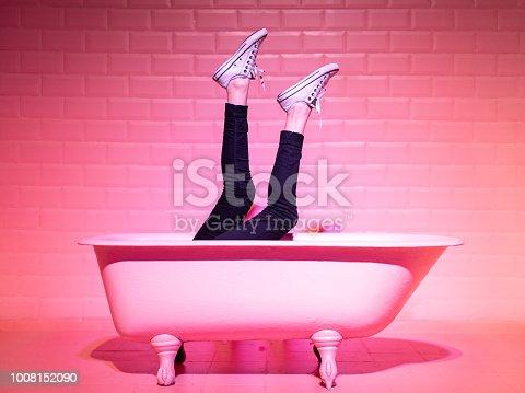 istock Woman Legs Having Fun in the pink bathtube 1008152090