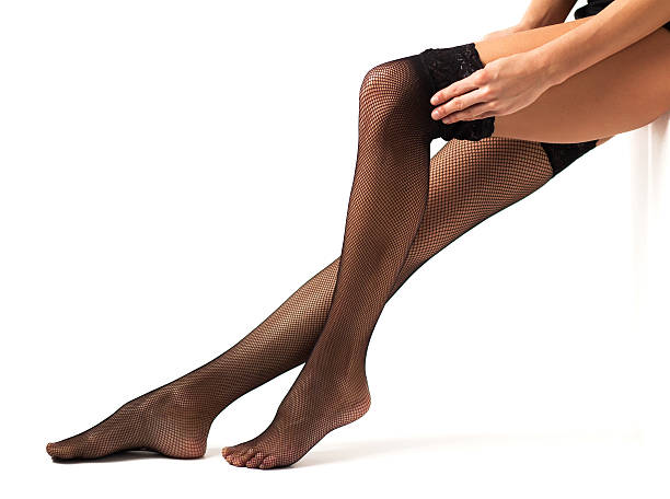 woman legs in black stockings - black women wearing pantyhose stock photos and pictures