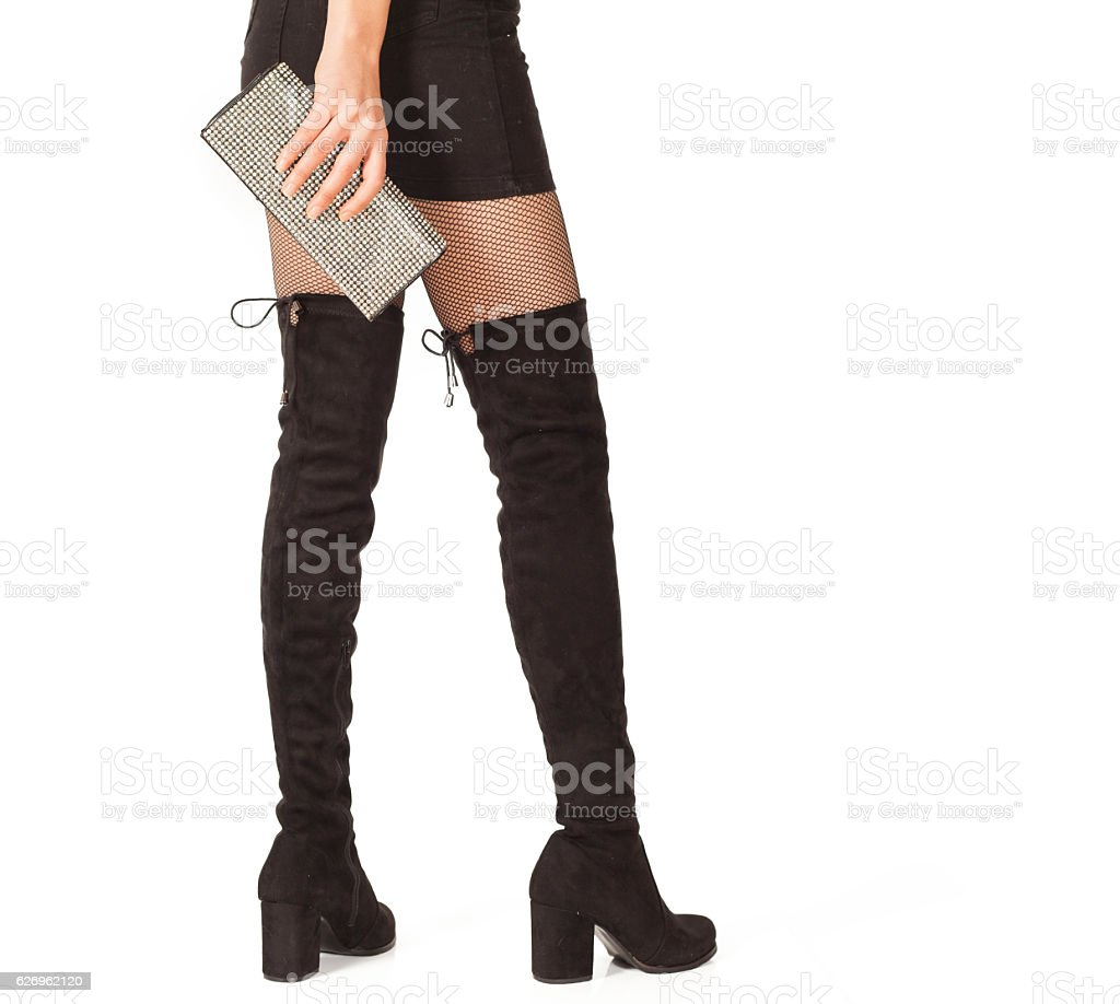 Woman legs in black suede boots on white background stock photo