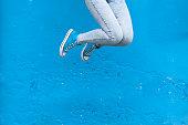 istock Woman legs in blue 698201508