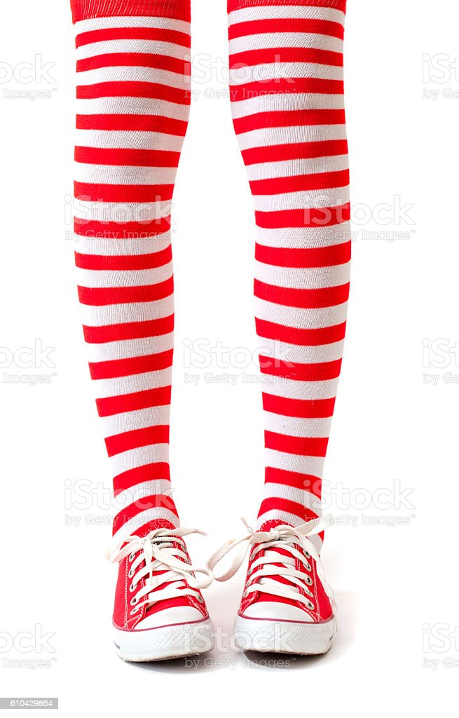 Woman legs in socks on white background stock photo