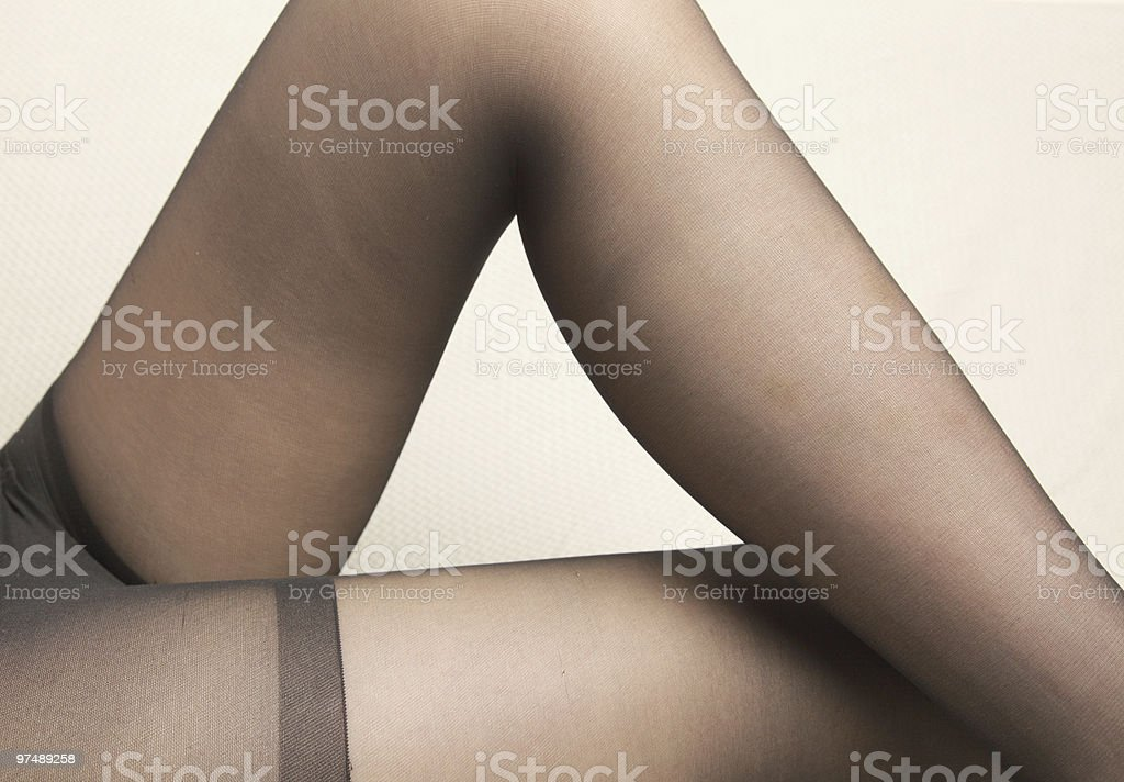Woman legs in stockings royalty-free stock photo
