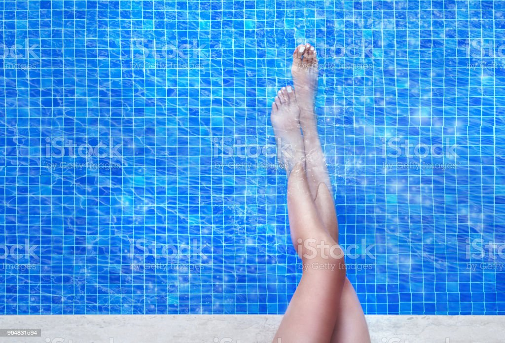 woman legs in swimming pool royalty-free stock photo