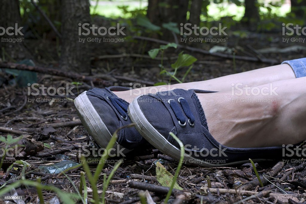 Woman legs in the forest stock photo