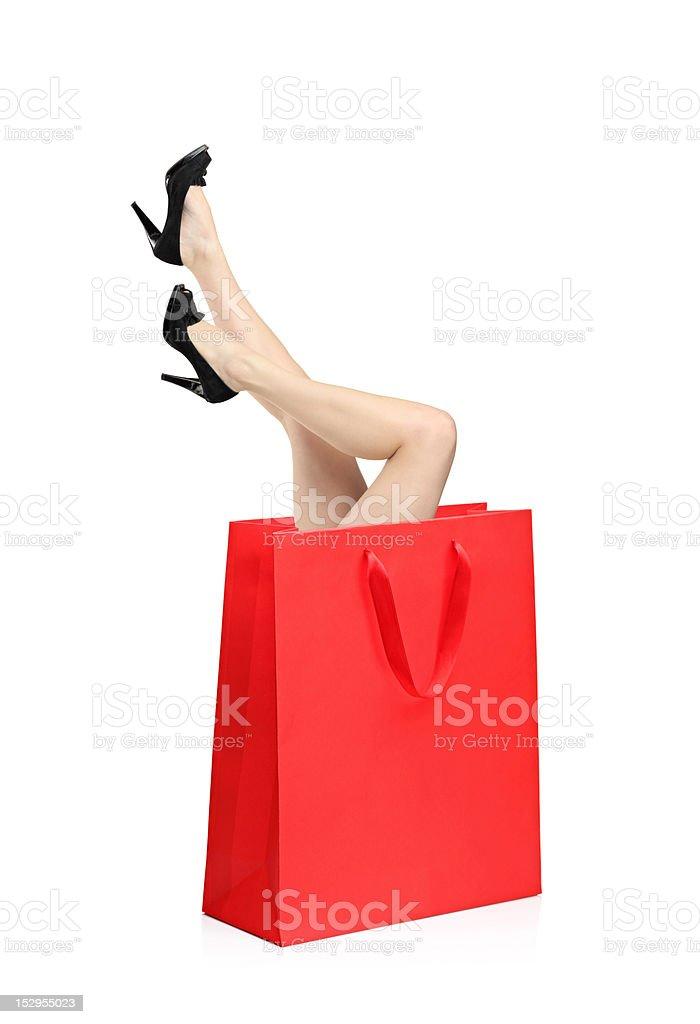 Woman legs inside a shopping bag royalty-free stock photo