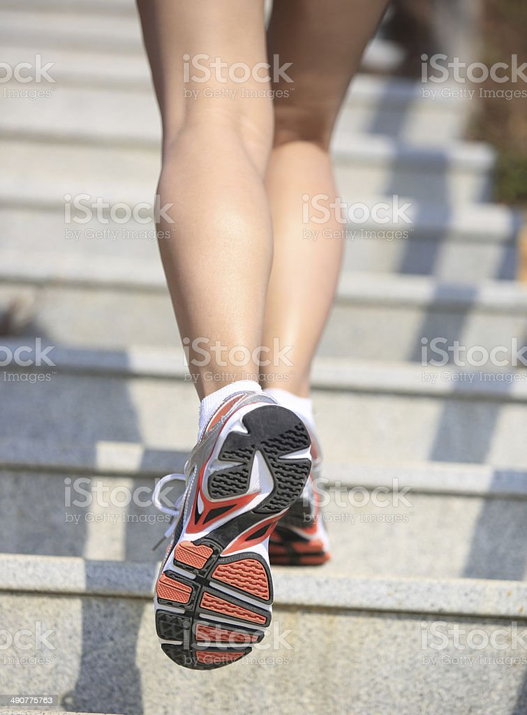 woman legs running up on mountain stairs royalty-free stock photo