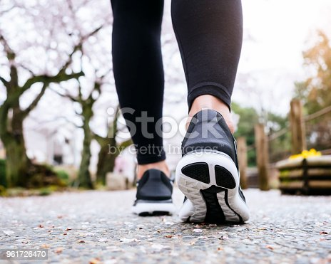 Woman Legs Sport shoe walk in Park outdoor Sakura Cherry blossom Japan Travel