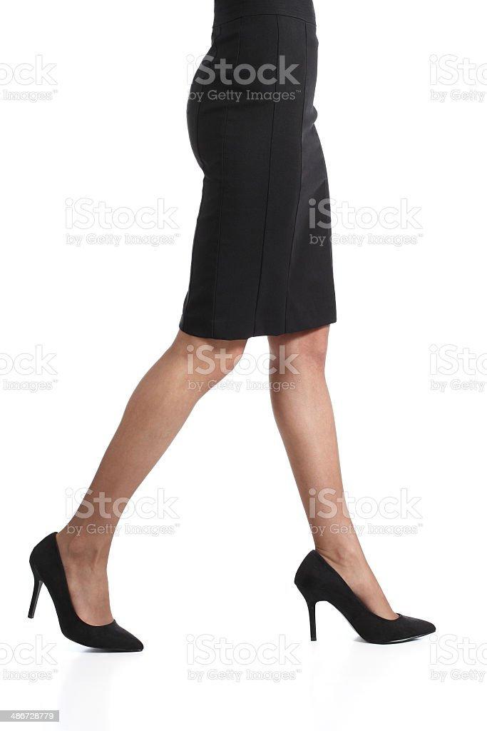 Woman legs walking with pencil skirt and nylons stock photo
