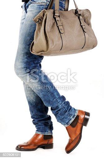 636803682 istock photo woman legs with fashion bag 522908101