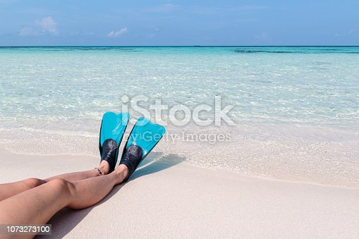 holiday in paradise concept. woman relaxing on the beach and contemplating the idyllic view