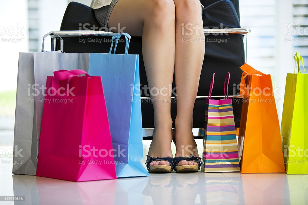 Woman Legs with Shopping Bags royalty-free stock photo
